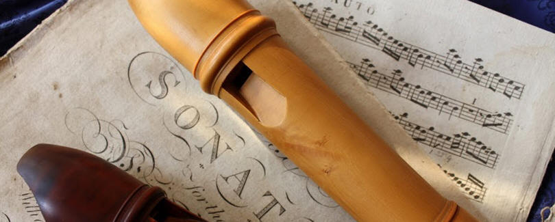 footer image: a recorder and some sheet music